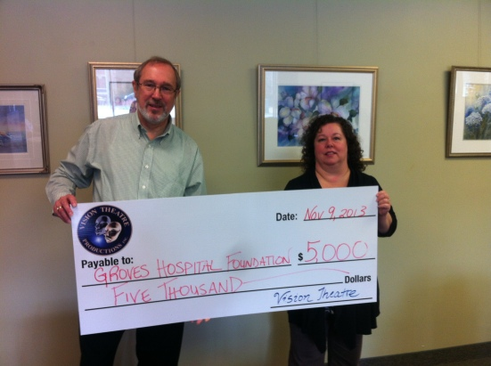 Vision Theatre Productions donated $5,000 to the Groves Hospital Foundation through sponsorship and support of M*A*S*H. Pictured are VTP Executive Producer Fred Morris and Foundation Representative Sherri Sutherland.